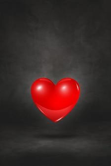 Coração 3d vermelho isolado em um fundo preto do estúdio. ilustração 3d