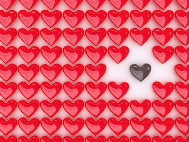 Coração de chocolate entre uma pilha de corações vermelhos