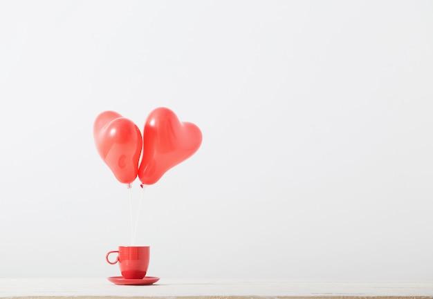 Coração em forma de balões vermelhos em fundo branco