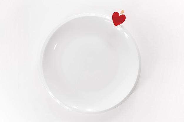 Coração pequeno ligado à placa