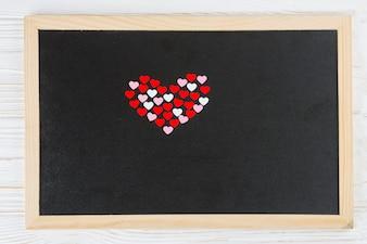 Corações decorativas na moldura