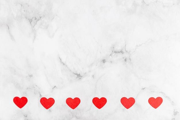 Corações em fundo de mármore
