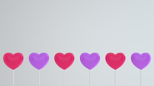 Corações rosa e roxos em uma vara em uma parede branca