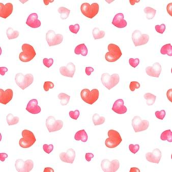 Corações rosa, vermelhos em aquarela sobre fundo branco. padrão sem emenda romântico.