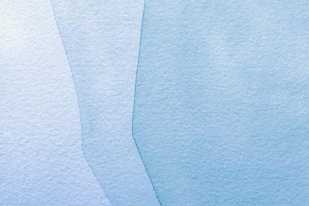 Cores azuis claras do fundo da arte abstrata. pintura em aquarela sobre tela com gradiente de jeans.