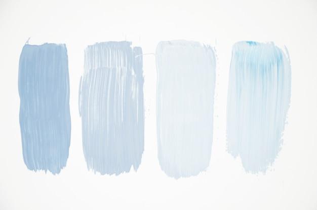 Cores azuis pálidas na tela branca