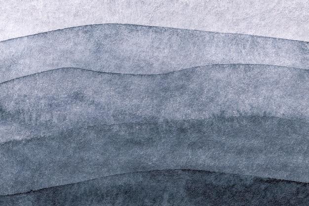 Cores cinza e azuis do fundo da arte abstrata. pintura em aquarela sobre papel com gradiente de prata.