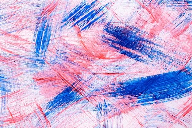 Cores claras de fundo azul e vermelho da arte abstrata. pintura em aquarela sobre tela com pinceladas de cor rosa e respingos. arte em acrílico sobre papel com padrão pontilhado. pano de fundo de textura.