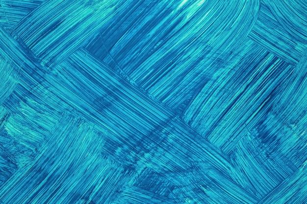 Cores de azul marinho e cerúleo de fundo de arte abstracta. pintura em aquarela sobre tela com pinceladas turquesas escuras e respingos. arte em acrílico sobre papel com padrão pontilhado de safira. pano de fundo de textura.