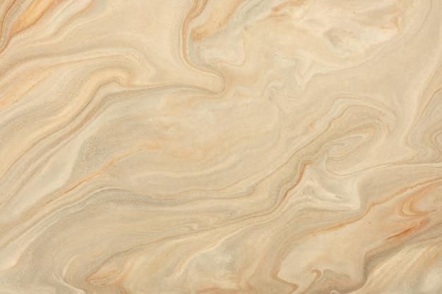 Cores marrons e bege da arte fluida abstrata. mármore líquido. pintura acrílica com gradiente de pérolas de areia. seção de pedra.