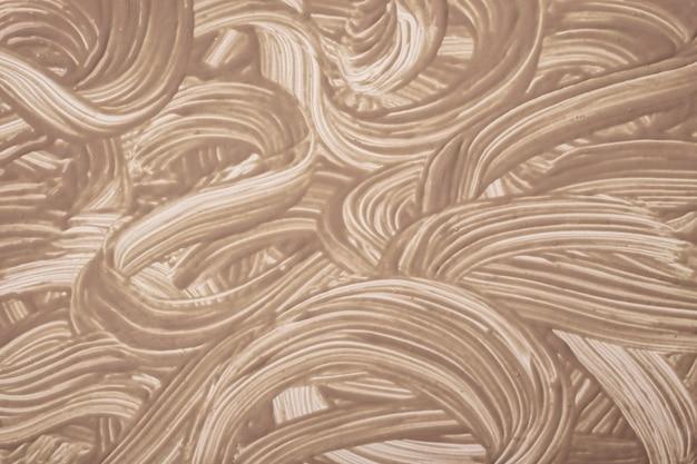 Cores marrons e bege escuras do fundo da arte abstrata. pintura em aquarela sobre tela com traços e respingos. arte em acrílico sobre papel com padrão encaracolado em pincelada. pano de fundo de textura.
