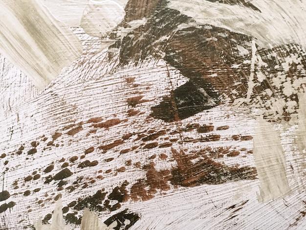Cores marrons e brancas do fundo da arte abstrata. pintura em aquarela sobre tela com gradiente bege. cenário de textura acrílica com padrão de respingos.