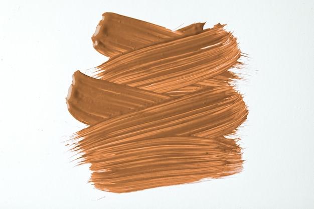 Cores marrons e brancas do fundo da arte abstrata. pintura em aquarela sobre tela com traços bege e respingos. arte em acrílico sobre papel com amostra de bronze. pano de fundo de textura.