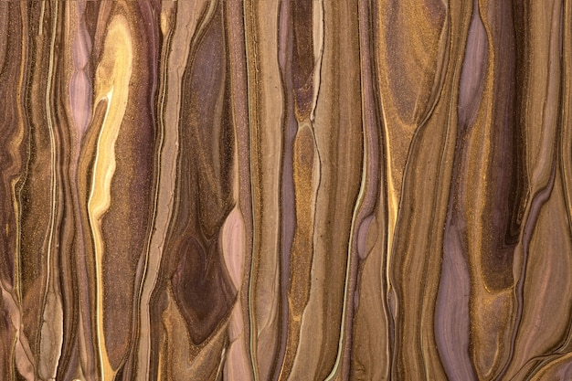 Cores marrons e douradas escuras da arte fluida abstrata. mármore líquido. pintura acrílica com gradiente de bronze.