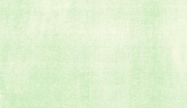 Cores pastéis verdes pintando em fundo abstrato de textura de tela