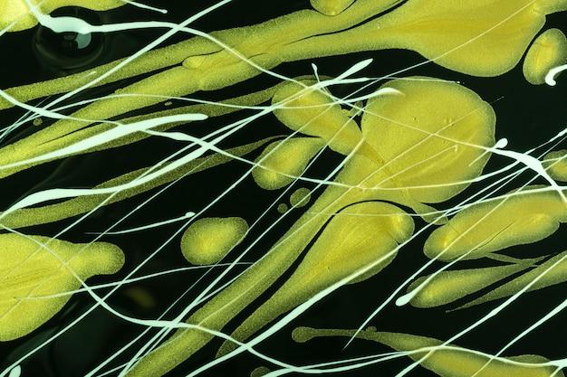 Cores pretas e verdes do fundo abstrato da arte fluida. mármore líquido. pintura acrílica sobre tela com linhas brancas e gradiente. cenário de tinta a álcool com padrão ondulado.