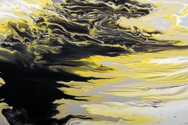 Cores tendências de 2021. ondas de cinza, amarelo e preto fluem. fundo ou textura do efeito de mármore. fluid art.