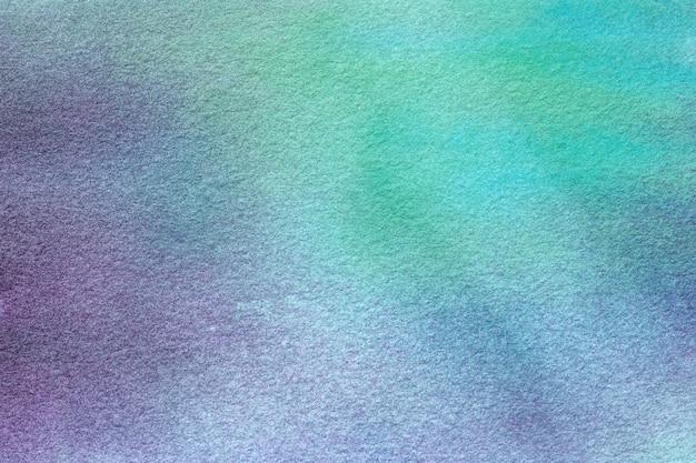 Cores verdes e azuis claras. pintura em aquarela sobre tela com gradiente de roxo.