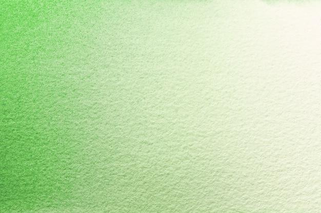 Cores verdes e brancas claras do fundo da arte abstrata. pintura em aquarela sobre tela com gradiente de oliva.