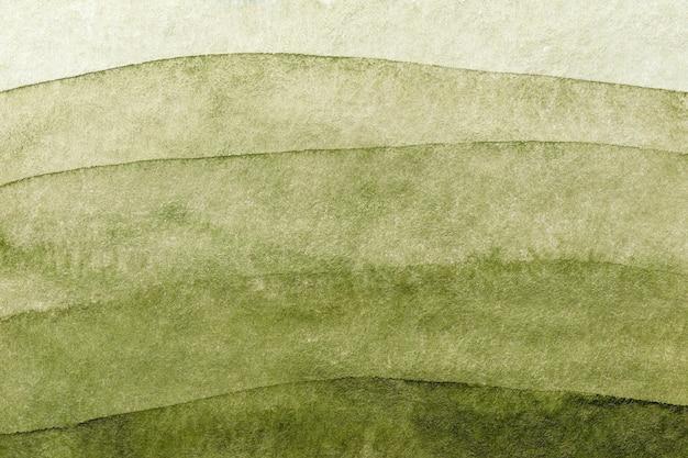 Cores verdes e verde-oliva do fundo da arte abstrata. pintura em aquarela sobre papel áspero com gradiente verde.