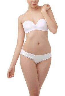 Corpo de mulher bonita e saudável em cueca branca