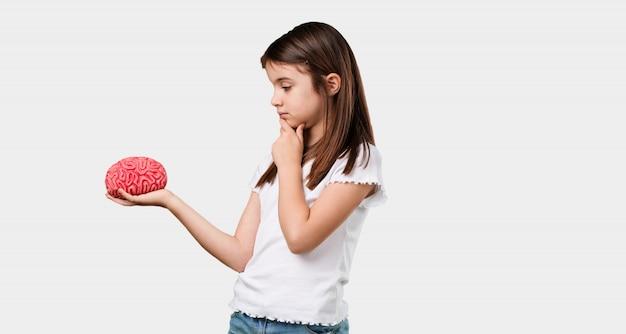 Corpo inteiro, menininha, pensando, e, deduzir, olhar, um, cérebro, tentando, entender