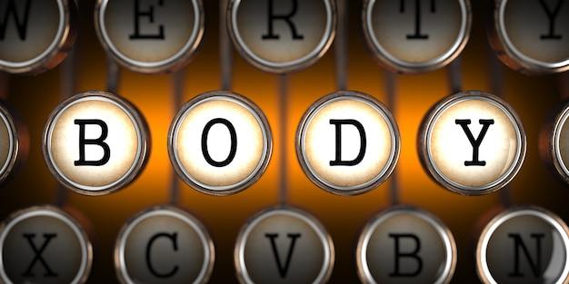 Corpo nas chaves da velha máquina de escrever em laranja.