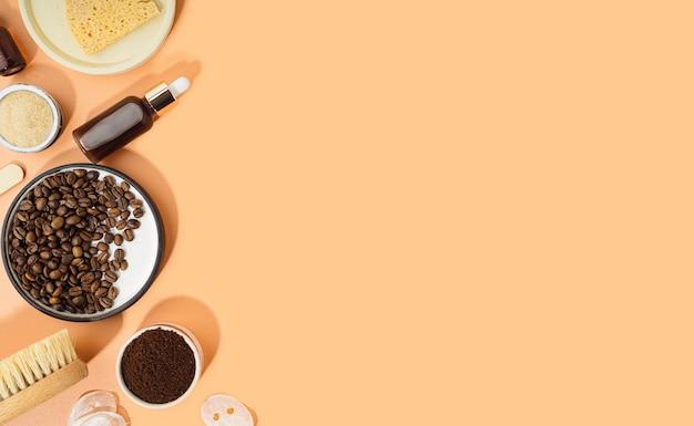 Cosméticos caseiros com esfoliante de café e óleo. conjunto de produtos cosméticos spa em casa. escova a seco, esfoliante de café, óleo orgânico. cosmético caseiro anticelulite para peeling e cuidados spa. copie o espaço