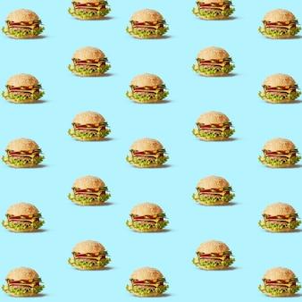Costura padrão de hambúrgueres com legumes em uma textura azul. pode ser usado como pano de fundo para suas ideias