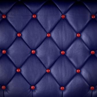 Couro genuíno azul profundo com botão vermelho