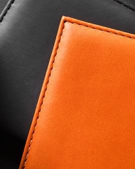 Couro preto e laranja de qualidade em close-up