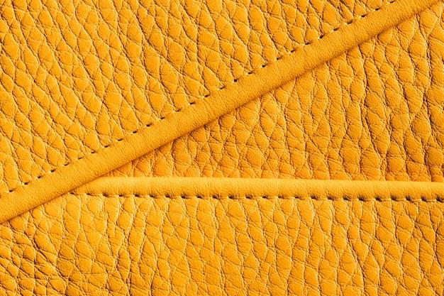 Couro texturizado amarelo de qualidade em close-up
