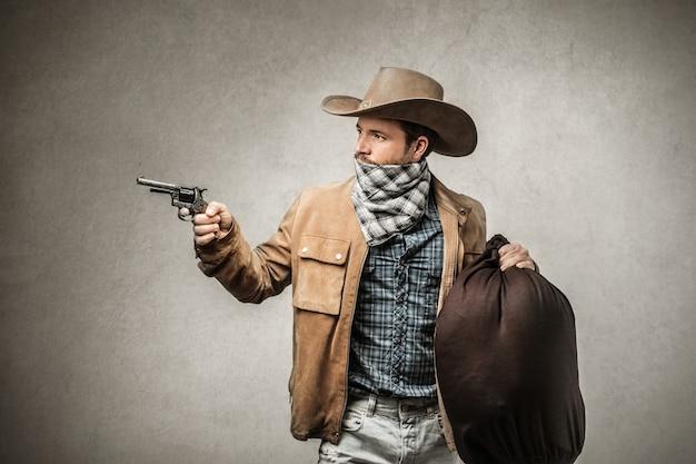Cowboy com uma arma