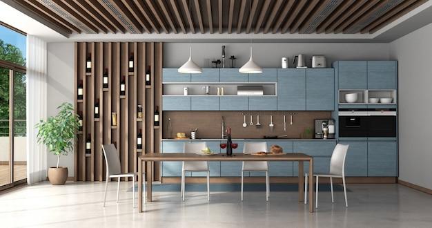 Cozinha azul e madeira com mesa de jantar