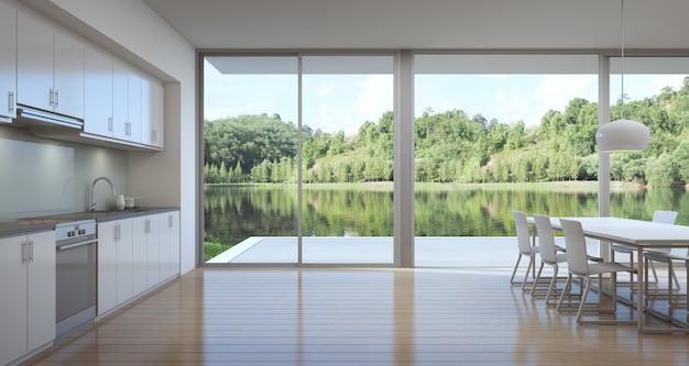 Cozinha e sala de jantar da casa de luxo com vista para o lago em design moderno.