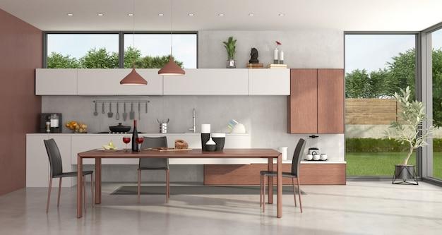 Cozinha moderna com mesa de jantar e cadeiras