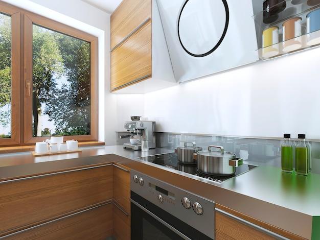 Cozinha moderna na sala de jantar de estilo contemporâneo com exaustor sobre o fogão