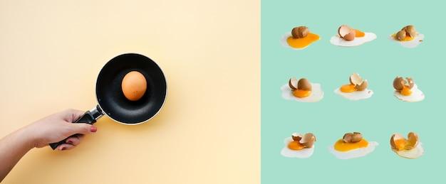 Cozinhando comida deitada com mão feminina cozinhando ovo na panela preta