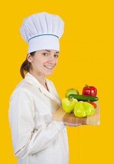 Cozinhar mulher com vegetais