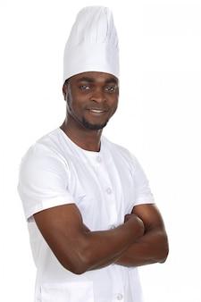 Cozinheiro atraente africano um sobre fundo branco