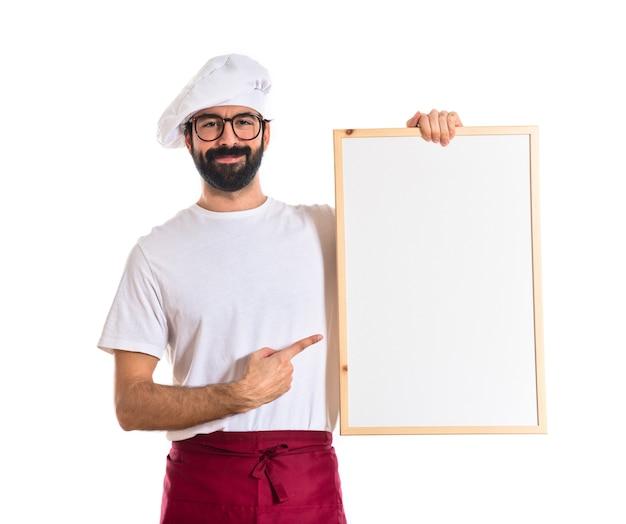 Cozinheiro chefe com cartaz vazio
