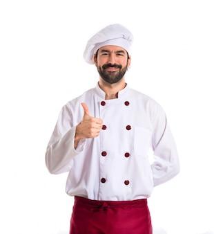 Cozinheiro chefe com o polegar acima sobre fundo branco