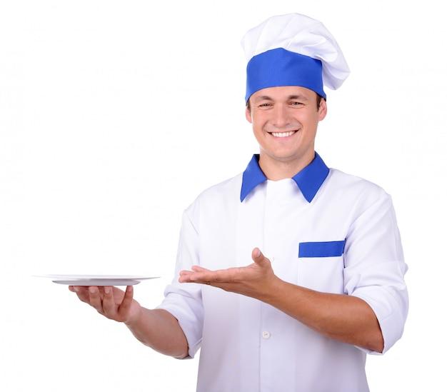 Cozinheiro do cozinheiro chefe na placa branca entregando uniforme, isolada no branco.