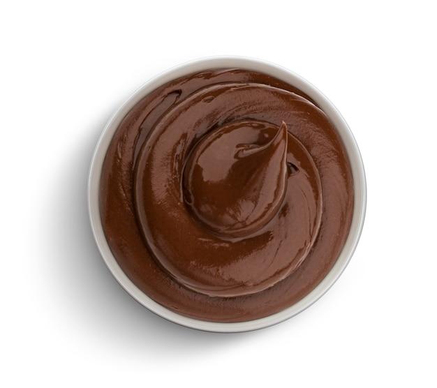 Creme de chocolate isolado no branco, vista superior