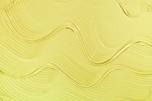 Creme gel amarelo transparente amostra cosmética textura ondas de fundo