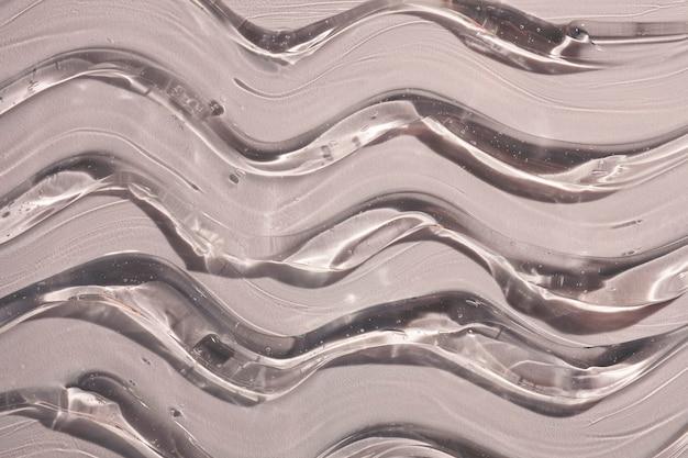 Creme gel cinza transparente amostra cosmética textura ondas de fundo