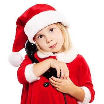 Criança com chapéu de papai noel. criança de natal isolada em fundo branco