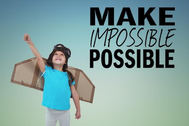 Criança feliz com asas de papelão e frase inspirada