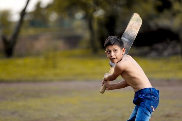 Criança, jogando críquete