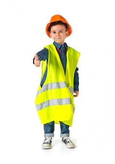 Criança, vestido, como, um, trabalhador, com, polegar cima